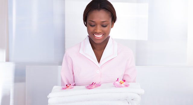 Housekeeper with Towel on hand